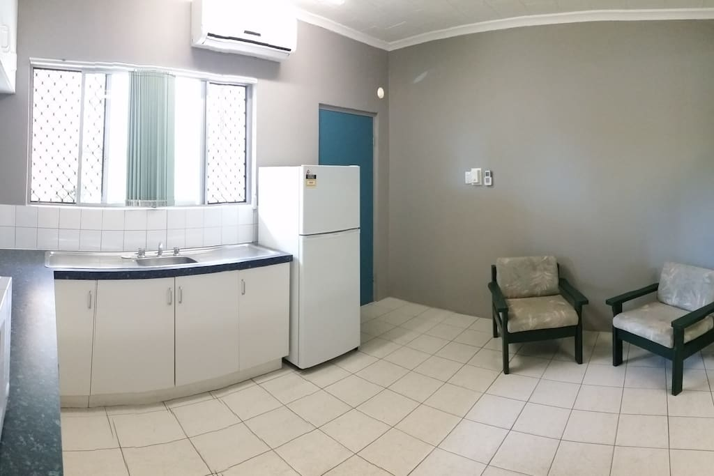It is tiled throughout, with air conditioning for the hotter months.  There are two armchairs.  No television is offered - there are better things to do in Darwin than watch TV!