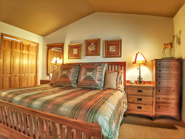 Master Bedroom with  luxury king size mattress, a large closet & 2 dressers,  ensuite master bathroom, and an HD Flat Screen TV with cable & streaming capabilities. French doors lead directly onto the deck.