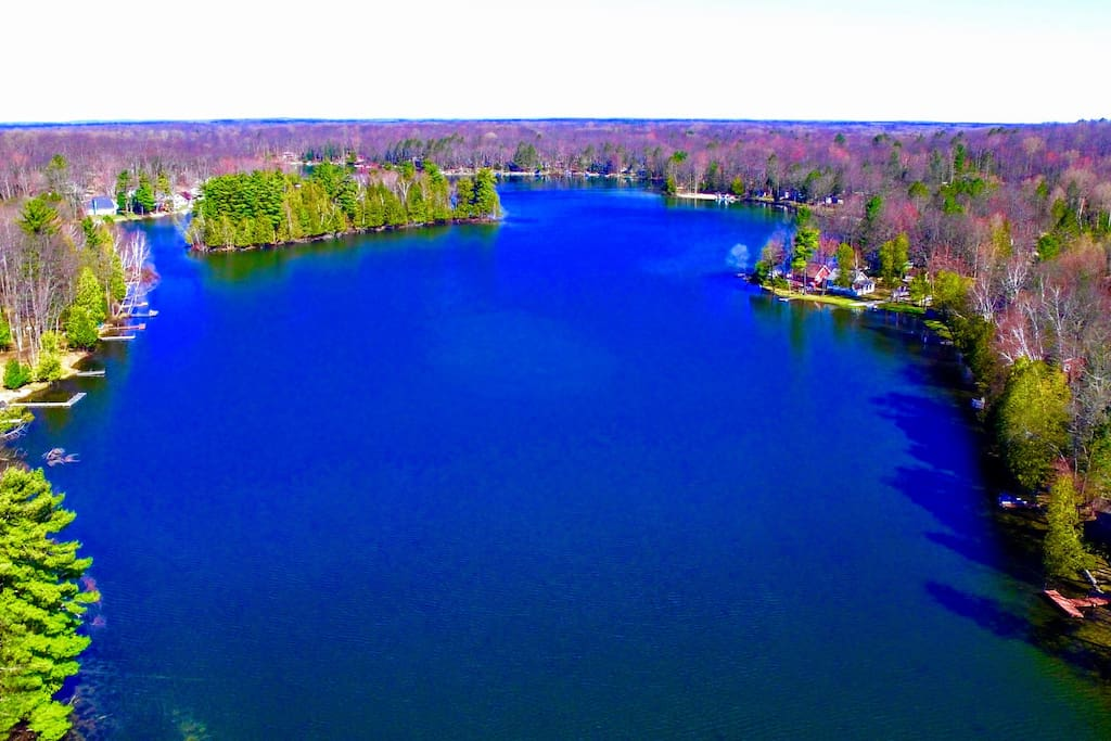Welcome to Island Lake, a beautiful 85-acre spring-fed lake on the edge of the Huron National Forest.  The population of our lake community is nearly 90% seasonal residents and vacationers who love the area as much as we do!