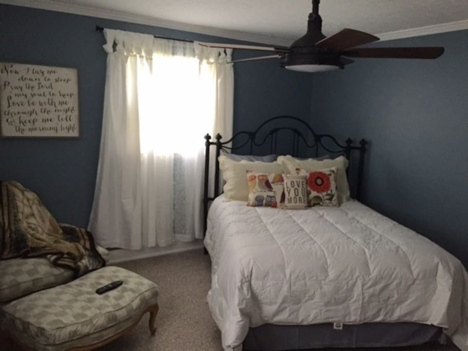 Master Suite with French chaise lounge chair and barn door closet