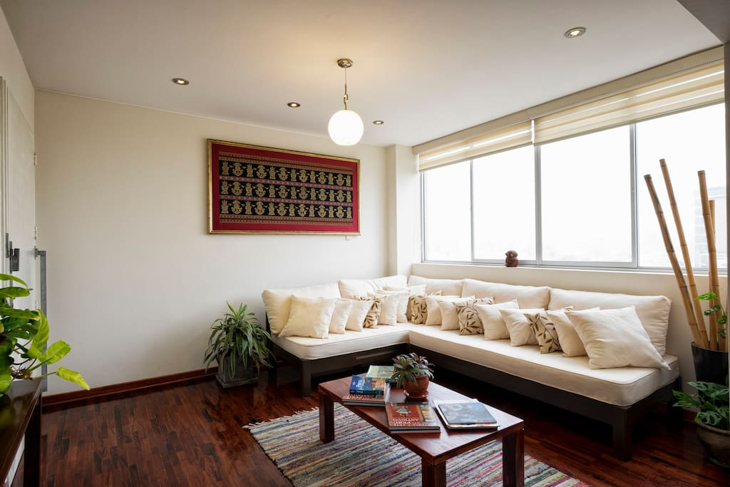 Relax in the bright and comfortable living room area.