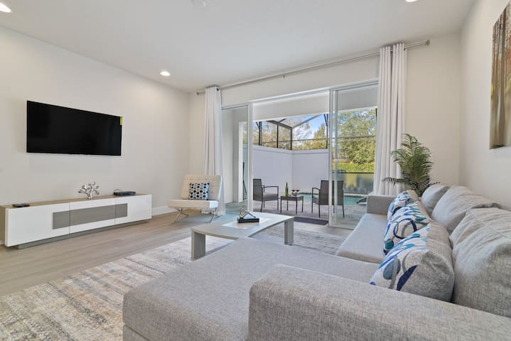 Living Room  located in the middle of the house features a SMART TV, sofa and nature view