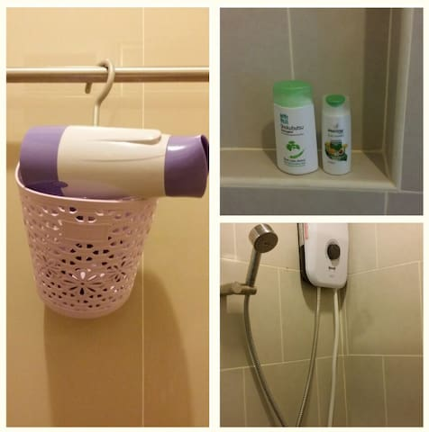 Water heater, hair dryer and toiletries provided in the bathroom.