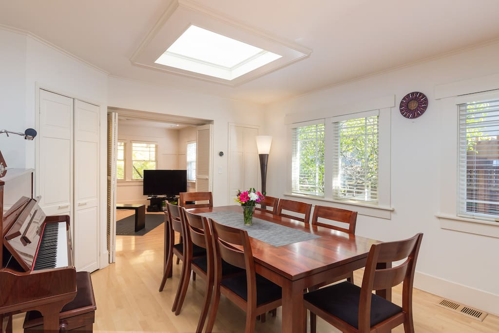 The dining room is also bright, and includes a piano for the musically-inclined