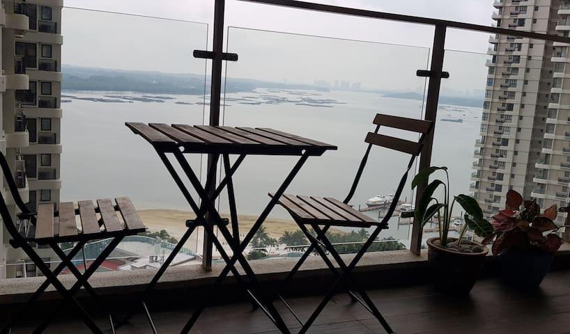 Sea views facing Singapore in shared balcony