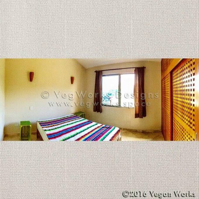 Bedroom with garden view, big wardrobe, Air- condition and roof- fan
