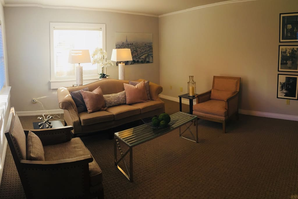 """Den.  Featuring a 50"""" smart television with DirectTV (includes the SEC Network), Netflix and Google Chromecast.  There is seating for 5 people.  Right outside the door is access to the French pea gravel garden."""
