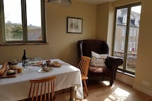 Dining area with view over garden and park beyond
