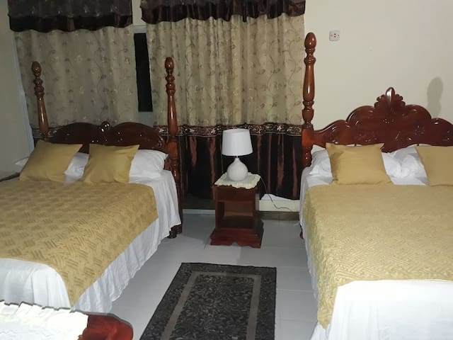 Large bedrooms with two comfortable double beds.