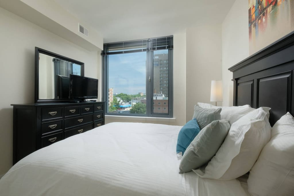 Master bedroom offers a queen bed with ample closet space and master bath.