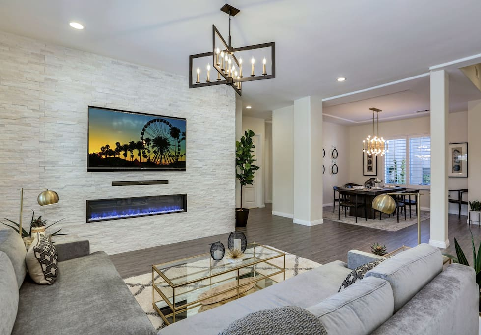 Stacked stone media wall, sectional seating and open floor plan perfect for entertaining