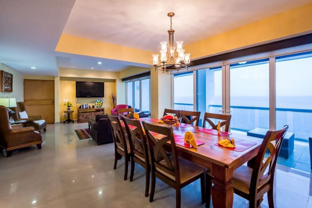 Comfortable living room with adjoining dining room. Both with ocean views.