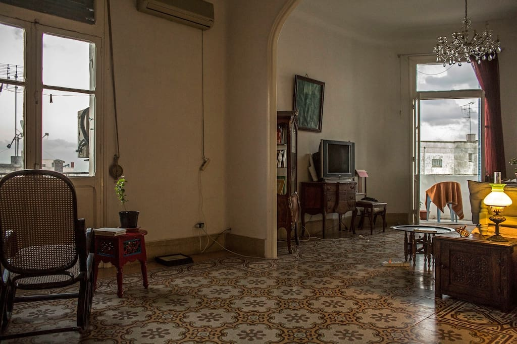 The well-lit living room hugs the corner of the building and has views over the Medina all the way to the ville coloniale