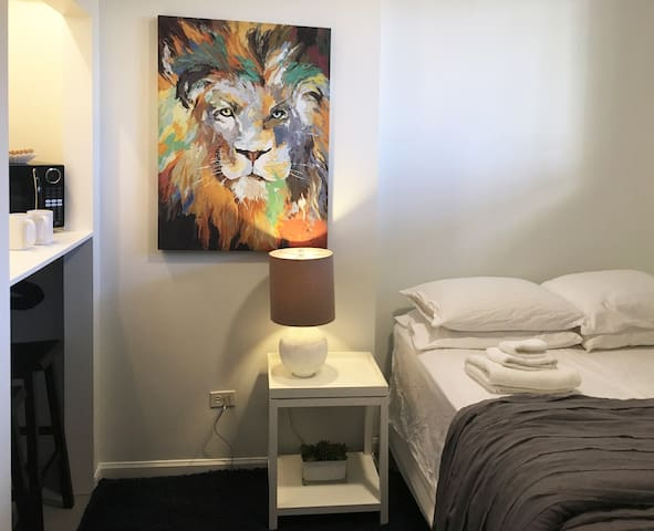 """Stylish Functional """"Capsule"""" Bedrooms in Boystown"""