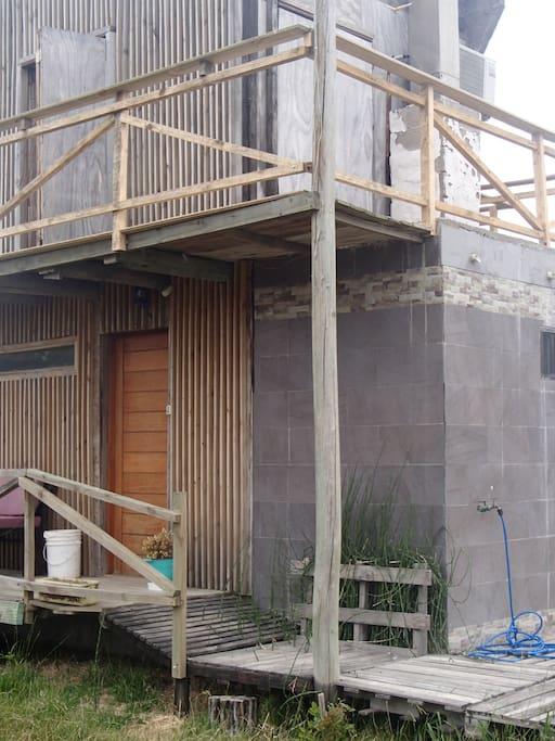 Terraza de planta alta con deck