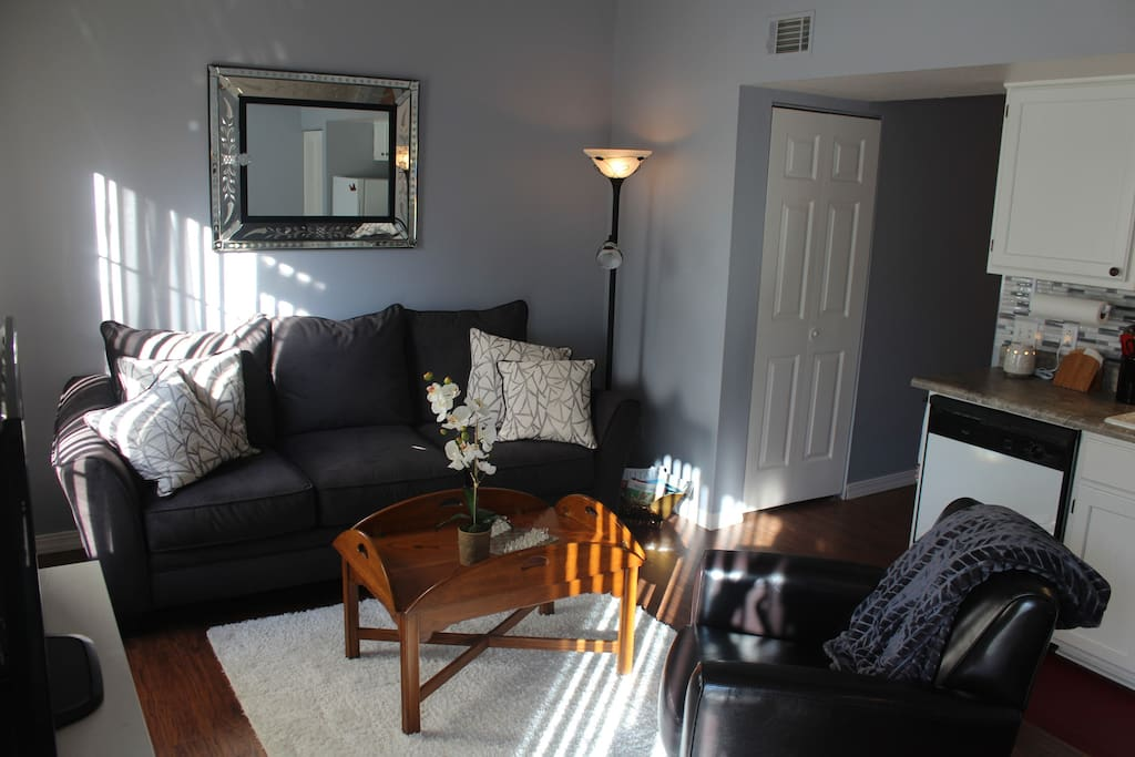 A comfy couch and leather chair provide plenty of seating.