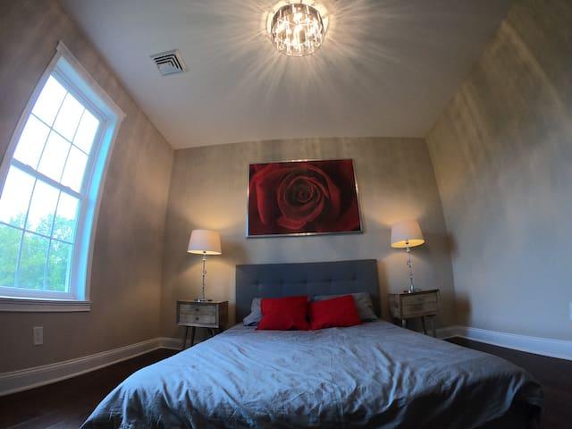 Bedroom 2. Queen bed.