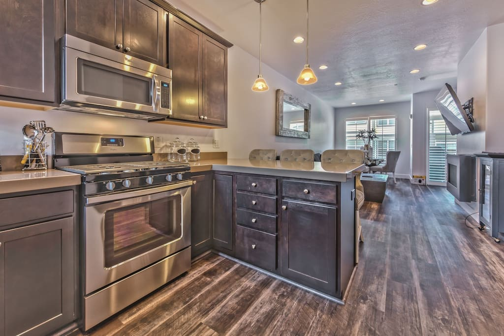 Main Level Great Room with Kitchen, Living Room and Dining Area with Beautiful Wood Flooring Throughout