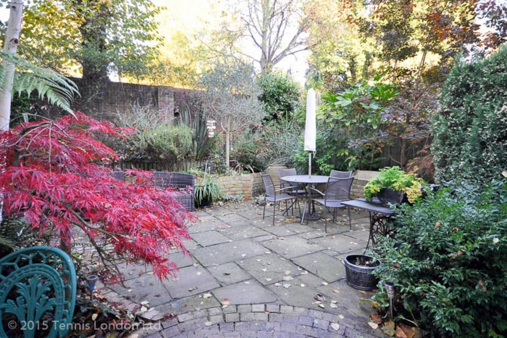 Picturesque garden with an outdoor seating area and water feature