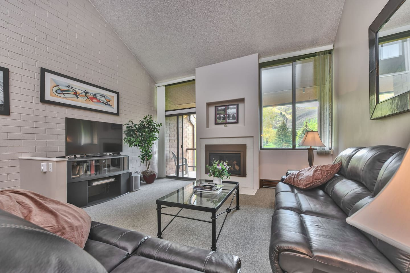 """Spacious Living Room with Golf Course and Mountain Views with Private Balcony,  Comfortable Furnishings, Gas Fireplace, 50"""" Smart TV and DVD"""