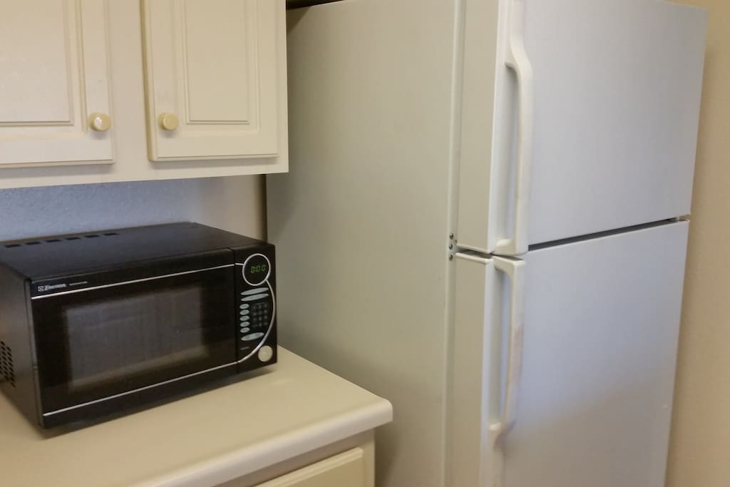 Kitchen with stove, oven, microwave and fridge.