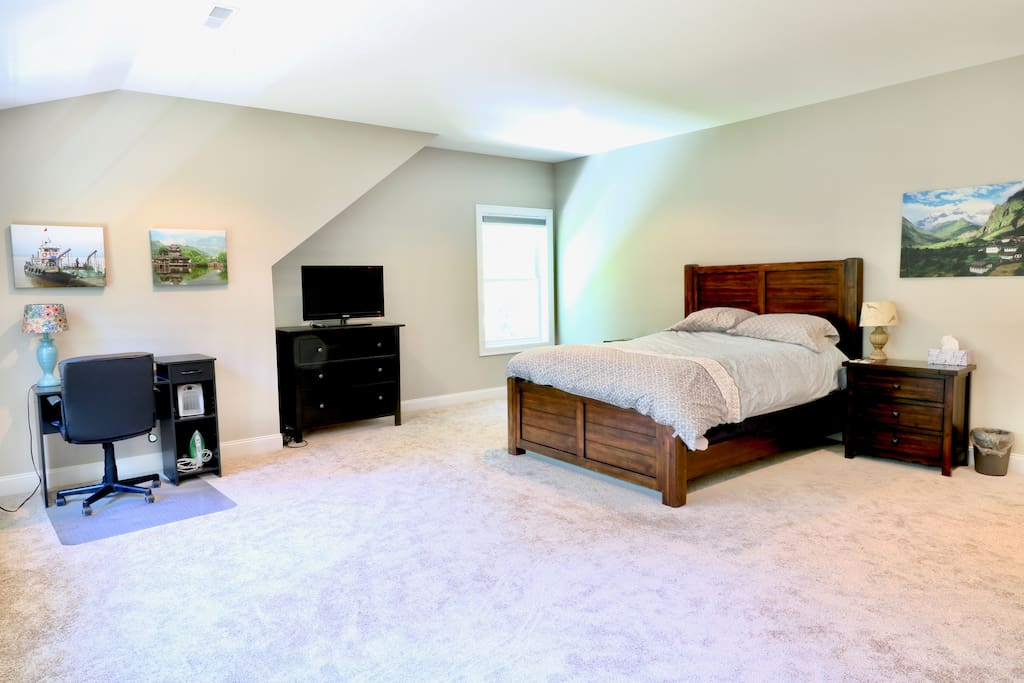 A work desk, clothes hanging rack, plenty of drawer space and TV are included in the main room.