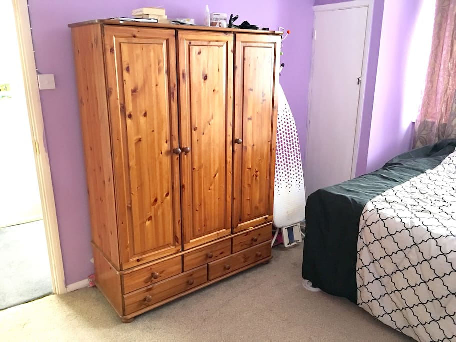 Wardrobe and iron board.