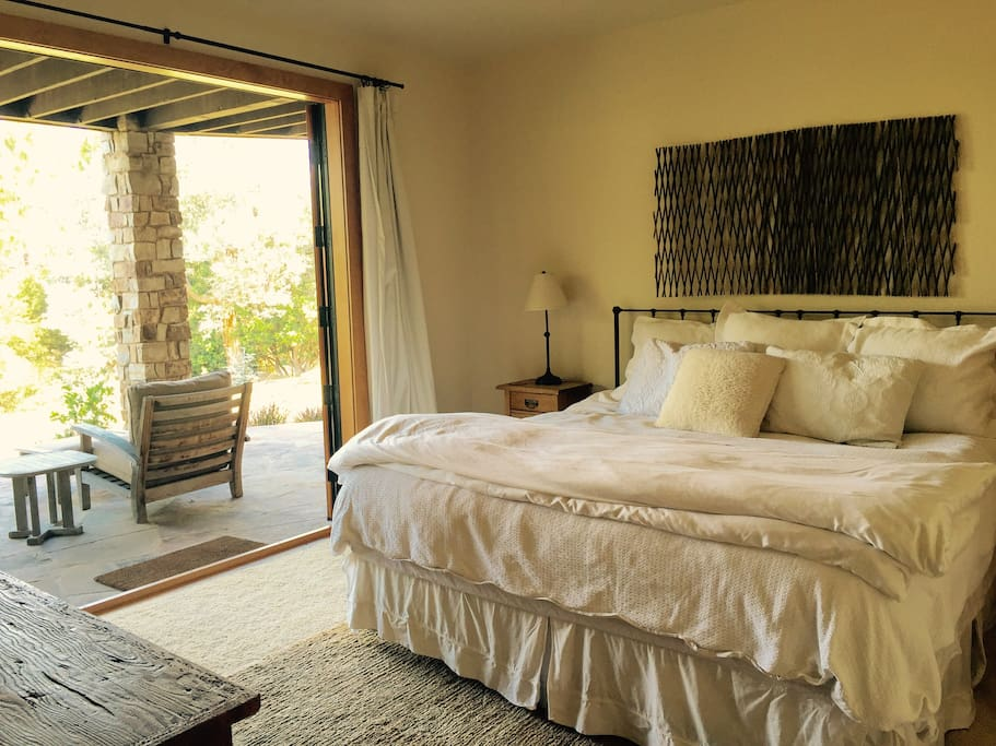 King Bedroom with Luxury Linens and double french doors