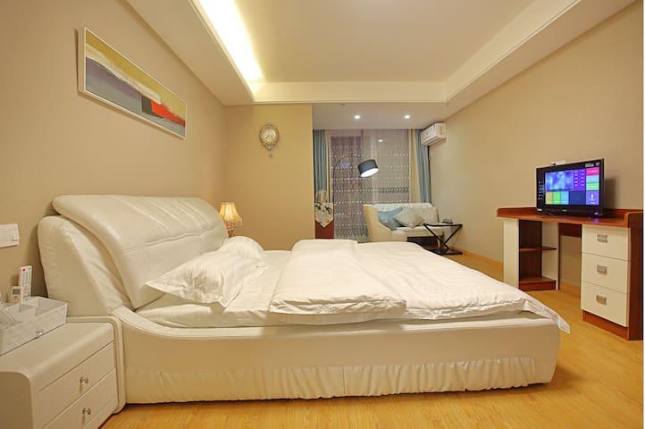 繁华都市中心酒店式公寓 给您家的感觉 - Huzhou - Pis