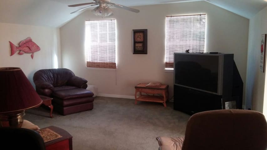 Large living area with mini fridge, microwave, cable tv and wifi.