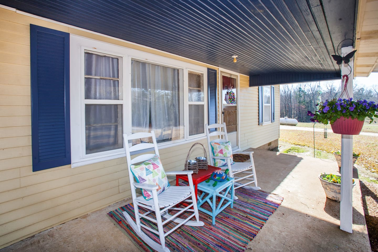 Spacious front porch. Enjoy a drink and a good book in this quiet and quaint country setting.