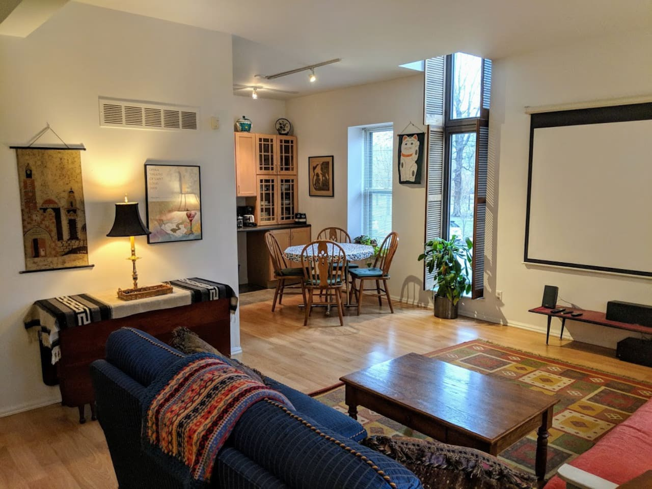 """Spacious living area with 100"""" projection screen. Netflix, Amazon Prime and more provided. You may also connect your own video or audio devices."""