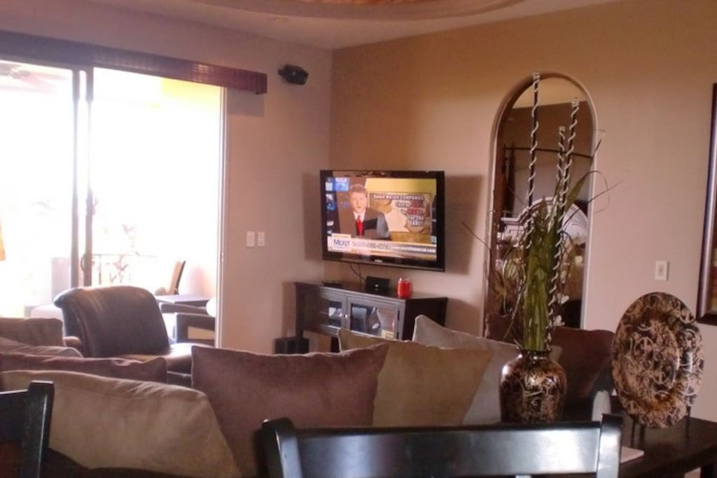 Dish Satellite TV with flat screen TVs in family room and both bedrooms