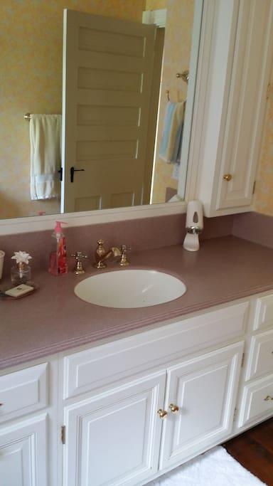 Shared hall bath with tub/shower combination.