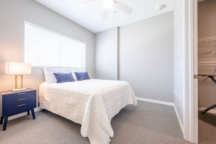 The smaller of the two bedrooms with a full-size bed.  There is also a ceiling fan in the bedroom.