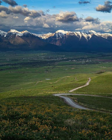 View from the road at the summit in the National Bison Range.  Looking east toward the Mission Mountain Range.