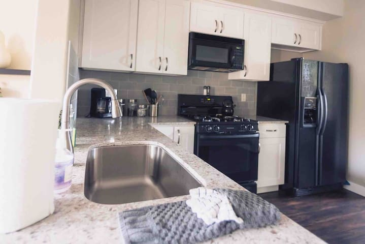 Sink overlooks the living room so you can chat with the group while preparing meals