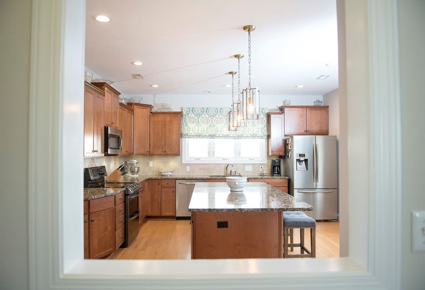 Gourmet Kitchen with granite countertops and large island