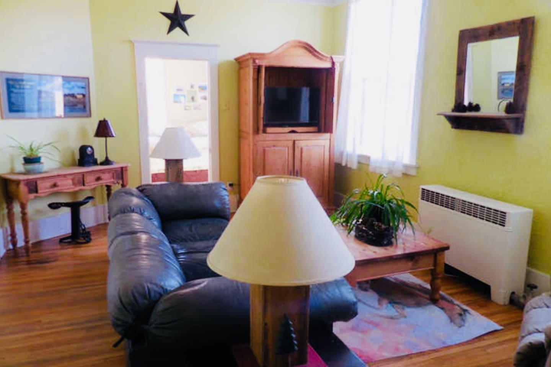 Living room peak into bedroom