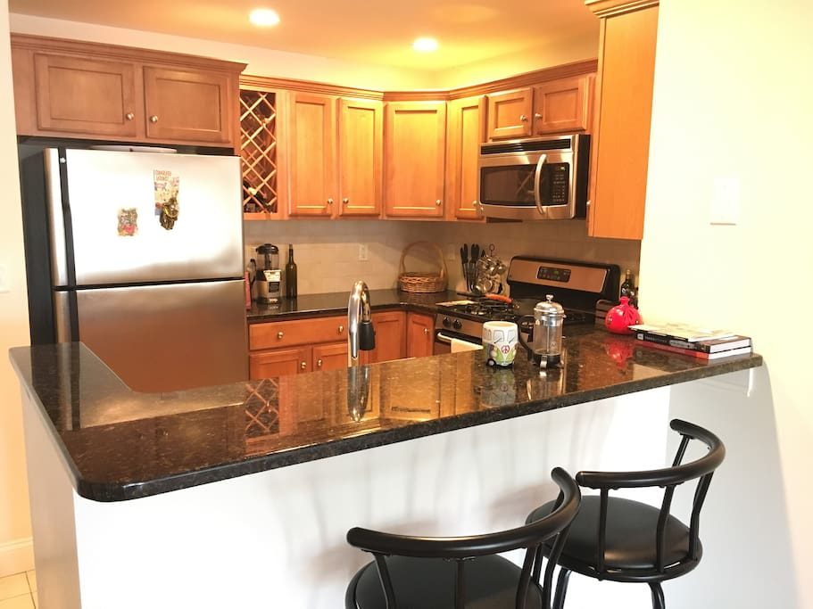 Fully appliances kitchen with breakfast bar
