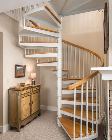 A charming stairwell takes you to the loft.