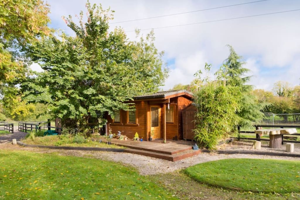 The Tara Room, a quiet wood cabin set in beautiful Tara Lodge for glamping style accommodation.