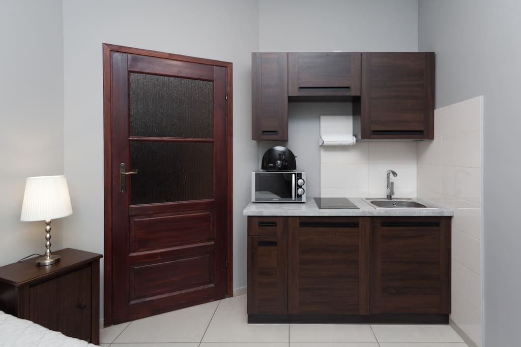 Bedroom with kitchenette