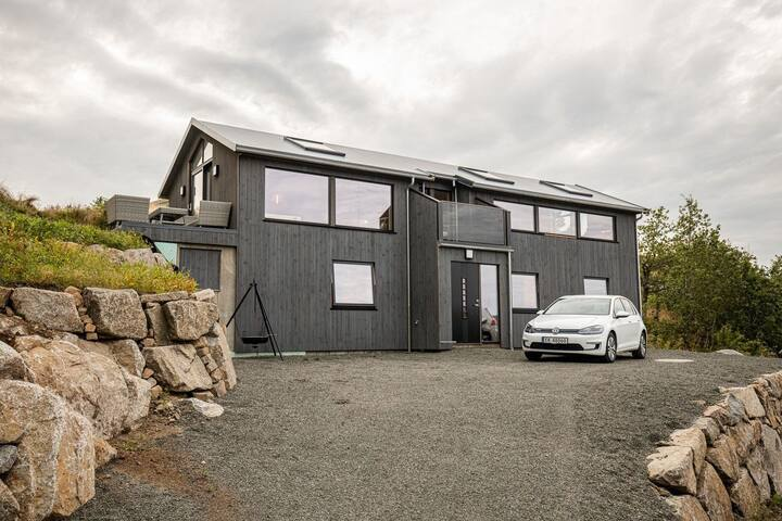 New and beautiful house by the sea. Boat available