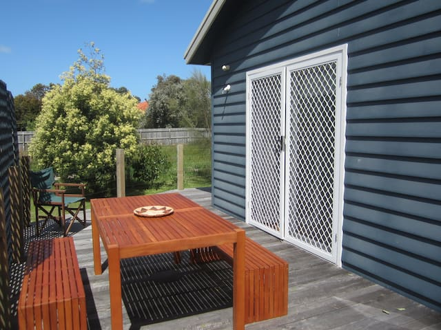 North facing dining area is out of the wind. There is also a BBQ.