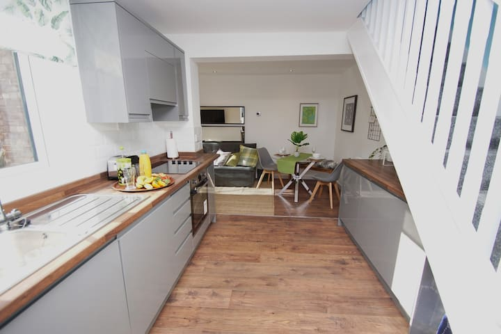 Open plan and airy, the apartment has a dining area and fully fitted kitchen