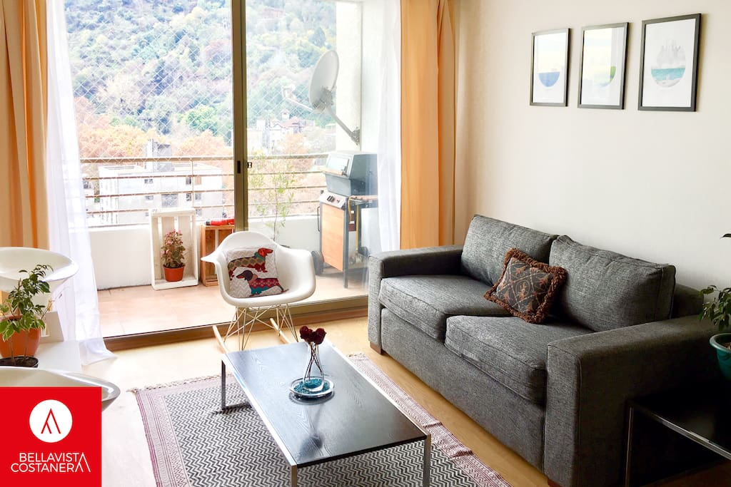 Living room and balcony, beautiful view: Cerro San Cristobal and Costaner Center.