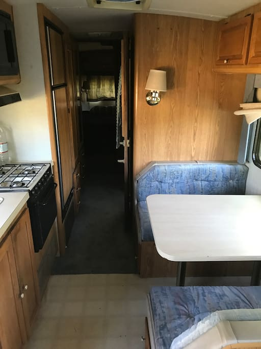 Kitchen and table that turns into a bed. In the back is the bedroom and bathroom