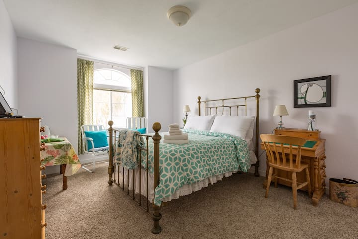 The double bed room includes TV, drinks station, writing desk, walk-in closet, chest of drawers and two chairs.