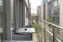 Balcony and furniture overlooking private roof garden